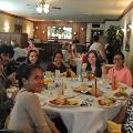 International students are enjoying the food at the end of the year dinner