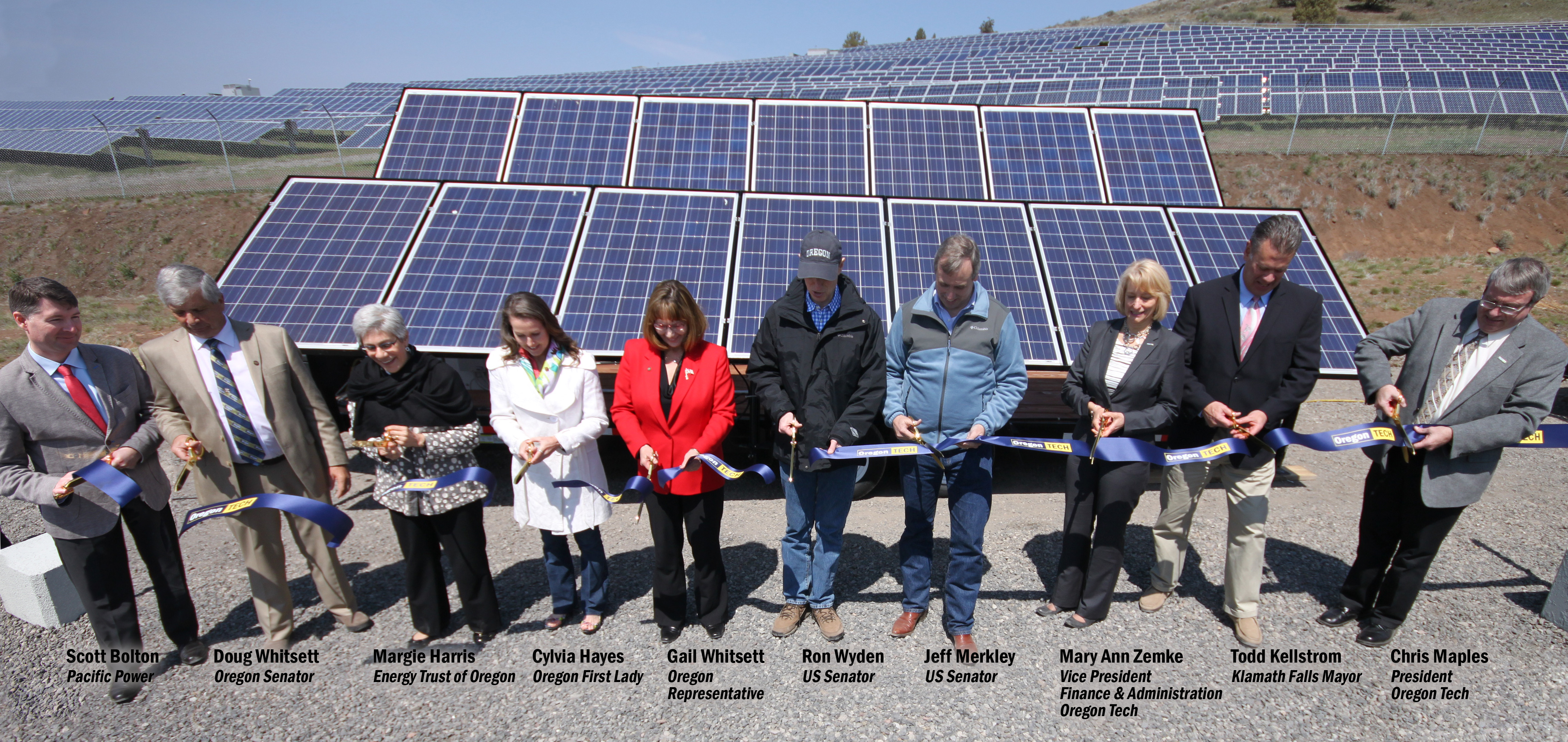 dignitaries at ribbon cutting solar event