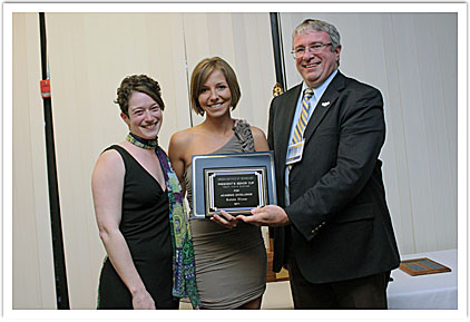 Kelsie Flynn accepting her award with Dr. Angela Amoia, faculty presenter & President Chris Maples