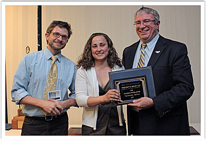 Mackenzie Garton accepting her award with Dr. Sean St. Clair, faculty presenter & President Chris Maples
