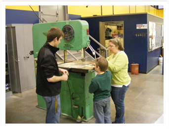 Cub Scouts learn more about the Band Saw