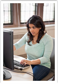 student studying at computer