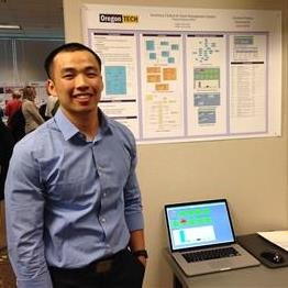 Student with poster at the 2016 student project symposium
